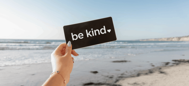 be-kind-hero-image-in-front-of-beach