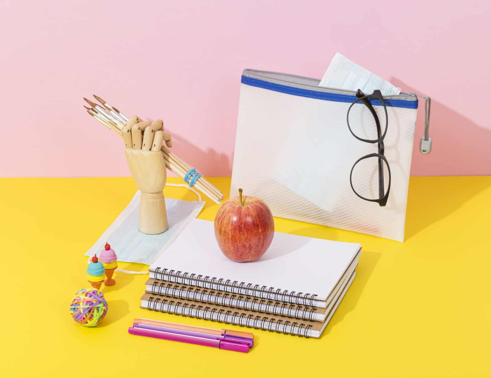 high-angle-school-supplies-with-notebooks-apple