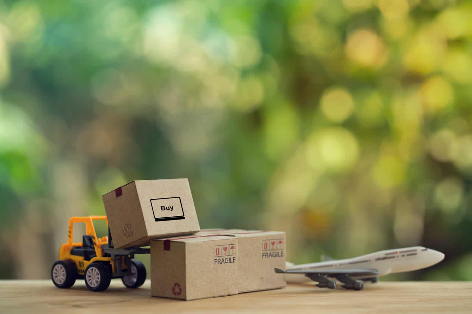 supply-chain-shortages-logistic-cargo-freight-concept-fork-lift-truck-moves-pallet-with-paper-boxes-plane